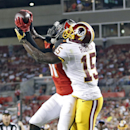 Tampa Bay Buccaneers defensive back Keith Lewis (41) intercepts a pass intended for Washington Redskins wide receiver Aldrick Robinson (15) during the second quarter of an NFL preseason football game Thursday, Aug. 28, 2014, in Tampa, Fla The Associated P