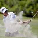 Adam Scott, of Australia, hits out of the bunker on the fourth hole during the first round of the PGA Championship golf tournament on the Ocean Course of the Kiawah Island Golf Resort in Kiawah Island, S.C., Thursday, Aug. 9, 2012. (AP Photo/Lynne Sladky)