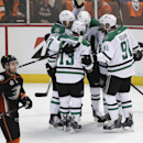 Dallas Stars' Alex Chiasson (12) celebrates his goal with Jamie Benn (14), Alex Goligoski (33) and Tyler Seguin (91) as Anaheim Ducks' Stephane Robidas(19) skates past them during the first period in Game 2 of the first-round NHL hockey Stanley Cup playof