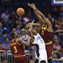 Cleveland Cavaliers' Tristan Thompson (13) blocks a shot by Orlando Magic's Maurice Harkless (21) as Dion Waiters (3) comes in to help during the first half of an NBA basketball game in Orlando, Fla., Wednesday, April 2, 2014 The Associated Press