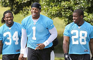 QB Cam Newton (C) with Panthers RBs DeAngelo Williams (L) and Jonathan Stewart. (AP)