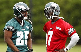 QB Michael Vick (R) with RB LeSean McCoy at an OTA session earlier this month. (AP)