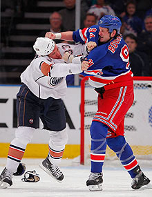 Boston University announced a diagnosis of mild chronic traumatic encephalopathy (CTE) in the brain of deceased enforcer Derek Boogaard (R), who died after mixing alcohol and painkillers in the summer.