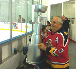 Paul Levy, 76, with the Stanley Cup replica he cobbled together in support of the Panthers. (Y! Sports)