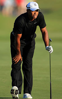 Tiger Woods stopped the talk of missing the cut with a string of four birdies. (Getty Images)