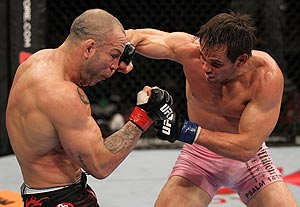 Rich Franklin (R) and Wanderlei Silva trade blows at UFC 147 in Brazil. (Getty)