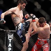 Carlos Condit delivers a knee to Nick Diaz during their fight for the UFC interim welterweight title.