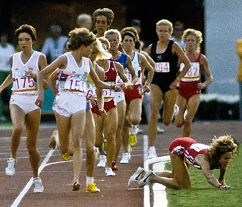 Zola Budd (wearing bib No. 151) looks back at Mary Decker, who's fallen into the infield. (US Presswire)