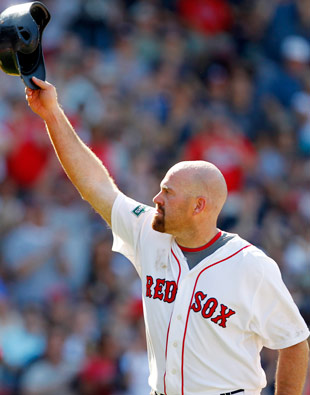 Kevin Youkilis tripled before leaving his final game with the Red Sox. (AP)
