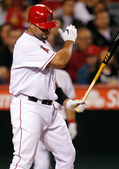 Albert Pujols reacts after striking out in the fifth inning on Monday. (AP)