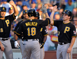 Travis Snider (far right) scored on a Neil Walker grand slam Tuesday. (AP)
