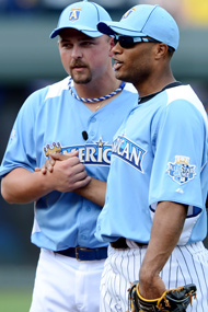 At the center of the storm: Billy Butler and Robinson Cano. (US Presswire)