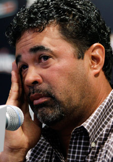 Ozzie Guillen flew to Miami on an off day for the Marlins. (AP)