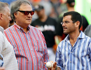 Architects of the con: owner Jeffrey Loria (center) and president David Samson (right). (AP)