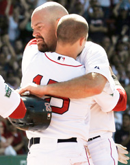 Kevin Youkilis got a hug from Dustin Pedroia. (Getty Images)