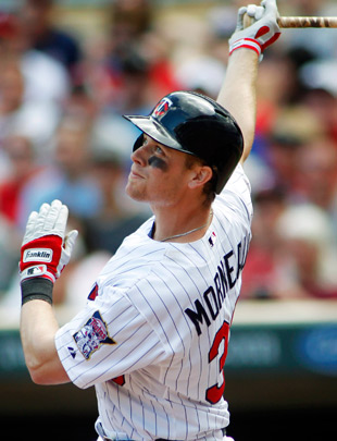 Justin Morneau strokes a single in a May 28 game against Oakland. (AP)