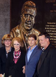 Members of the Steinbrenner family, including brothers Hank (far right) and Hal, pose in front a monument for George in 2010. (Getty Images)