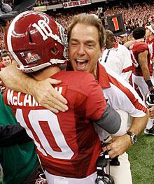 Alabama head coach Nick Saban celebrates with AJ McCarron after winning the BCS championship 21-0 against LSU.