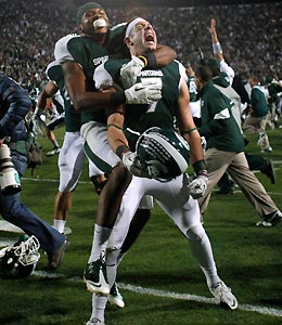 Michigan State's Keith Nichol (center) and B.J. Cunningham celebrate following a 37-31 win over Wisconsin.