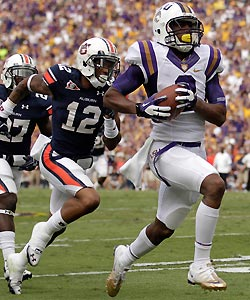 LSU wide receiver Rueben Randle (2) scores on a 42-yard touchdown reception as Auburn defensive backs Robenson Therezie (27) and Demetruce McNeal (12) pursue during the second quarter.