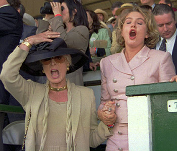 Doreen Tabor, left, wife of Michael Tabor, owner of Thunder Gulch, reacts to their Derby win in 1995. (AP)
