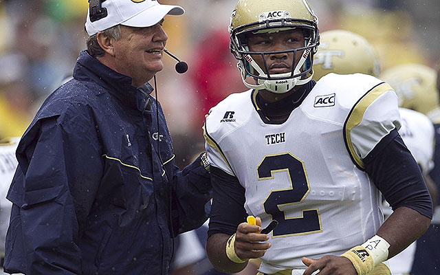 Paul Johnson confers with quarterback Vad Lee (2) during a game against UNC. (Getty)