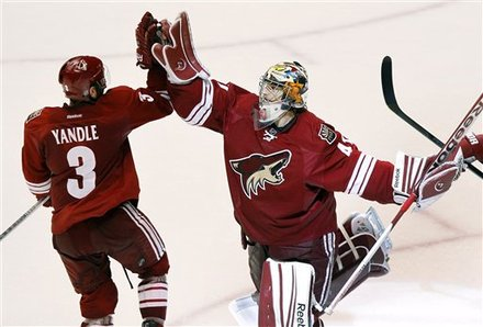 Phoenix Coyotes Goalie Mike Smith, Right, Celebrates Their 5-3 Win Over The Nashville Predators With Keith Yandle (3)