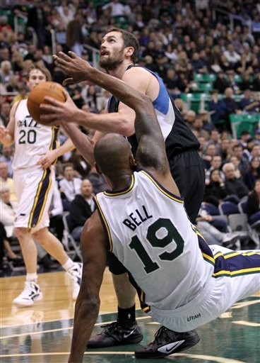 Utah Jazz Guard Raja Bell (19) Falls To The Court As Minnesota Timberwolves Center Kevin Love, Center, Attempt To Score