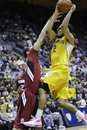 California guard Jorge Gutierrez (2) drives to the basket in front of Stanford forward Dwight Powell (33) in the second half of an NCAA college basketball game in Berkeley, Calif., Sunday, Jan. 29, 2012. California defeated Stanford 69-59.