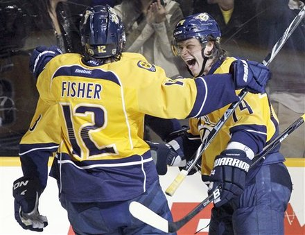 Nashville Predators Left Wing Sergei Kostitsyn (74), Of Belarus, Celebrates