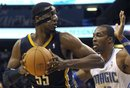 Indiana Pacers center Roy Hibbert , left, posts up against Orlando Magic center Dwight Howard during the first half of an NBA basketball game in Orlando, Fla., Sunday, Jan. 29, 2012.