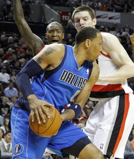 Dallas Mavericks Forward Shawn Marion, Left, Looks To Pass Against Portland Trail Blazers Forward Luke Babbitt, Right,