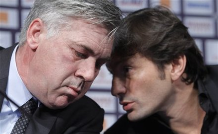 Paris Saint Germain (PSG) New Coach Carlo Ancelotti, Left, Of Italy, Chats With Sporting Director Leonardo, Of Brazil,