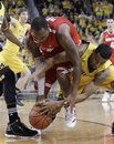 Ohio State forward Deshaun Thomas, left, and Michigan guard Trey Burke, right, scramble for a loose ball during the second half of an NCAA college basketball game in Ann Arbor, Mich., Saturday, Feb. 18, 2012.