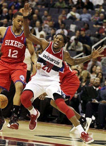 Washington Wizards Guard Cartier Martin (20) And Philadelphia 76ers Guard Evan Turner (12) Go