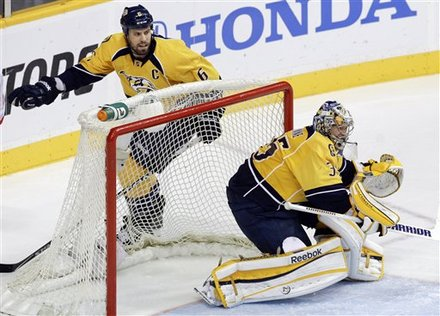 In This April 20, 2012 Photo, Nashville Predators Defenseman Shea Weber (6) And Goalie Pekka Rinne (35), Of Finland,