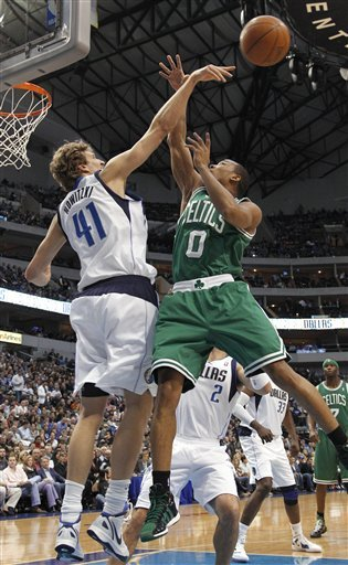 Dallas Mavericks Forward Dirk Nowitzki (41), Of Germany, Blocks A Shot By Boston Celtics Guard Avery Bradley For His 1,