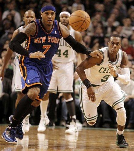 New York Knicks' Carmelo Anthony (7) And Boston Celtics' Rajon Rondo Eye A Loose Ball