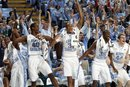 North Carolina 's Dexter Strickland (1), Harrison Barnes (40), John Henson (31), Reggie Bullock (35) and Tyler Zeller (44) reactn after they scored 100 points against Elon during the second half of an NCAA college basketball game in Chapel Hill, N.C., Thursday, Dec. 29, 2011. North Carolina won 100-62.
