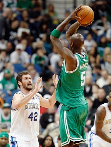 Boston Celtics Forward Kevin Garnett (5) Makes A Three-point Basket As Minnesota Timberwolves Forward Kevin Love (42)