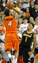 Missouri guard Phil Pressey (1) reacts to an unexpected shot by Oklahoma State guard Brian Williams (4) during the first half of an NCAA college basketball game in Stillwater, Okla., Wednesday, Jan. 25, 2012. Williams contributed 22 points as Oklahoma State won 79-72.