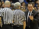 Duke head coach Mike Krzyzewski talks with officials during the first half of an NCAA college basketball game against Western Michigan in Durham, N.C., Friday, Dec. 30, 2011. Duke won 110-70.