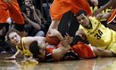 Oregon forward Devoe Joseph, right, dives in on Oregon State guard Roberto Nelson as Oregon's E.J. Singler lwatches at left during the second half of an NCAA college basketball game in Eugene, Ore., Sunday, Jan. 29, 2012. Oregon State beat Oregon 76-71.