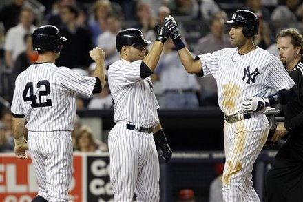 New York Yankees' Brett Gardner, Left, And Russell Martin, Center, Greet Derek Jeter At The Plate