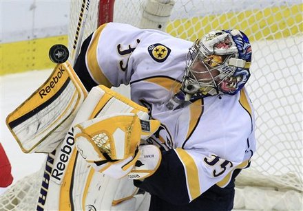 Nashville Predators Goalie Pekka Rinne (35) Of Finland Deflects