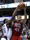 New Jersey Nets ' Kris Humphries (43) grabs a defensive rebound over Dallas Mavericks ' Ian Mahinmi , of France, in the second half of an NBA basketball game, Tuesday, Feb. 28, 2012, in Dallas. Humphries had 15 rebounds in the 93-92 win.