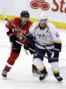 Nashville Predators ' Mike Fisher , right, is checked by Ottawa Senators ' Chris Phillips during third-period NHL hockey action in Ottawa, Ontario, Thursday, Feb. 9, 2012.