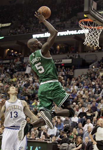 Boston Celtics Forward Kevin Garnett (5) Makes A One-handed Dunk Over Minnesota Timberwolves Guard Luke Ridnour (13)