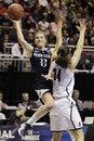 Penn State guard Maggie Lucas (33) goes up for a shot as Connecticut guard Kelly Faris (34) defends during the second half of their NCAA women's tournament regional semifinal college basketball game in Kingstown, R.I., Sunday, March 25, 2012. Connecticut won 77-59.