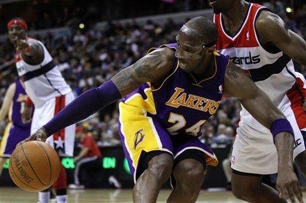 Los Angeles Lakers Guard Kobe Bryant (24) Scrambles
